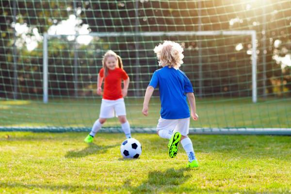 depositphotos_226479072-stock-photo-kids-play-football-outdoor-field